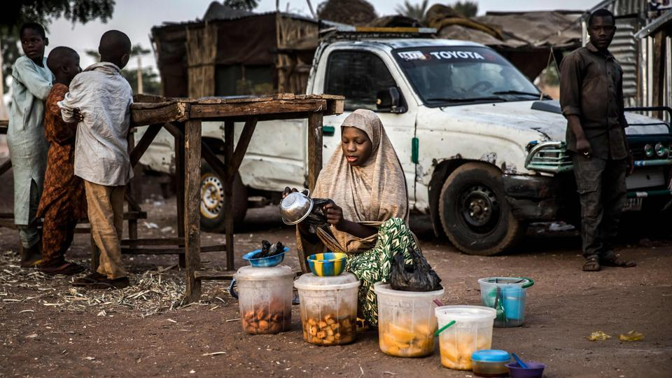 A woman selling food waits for costumers. Image for representation.