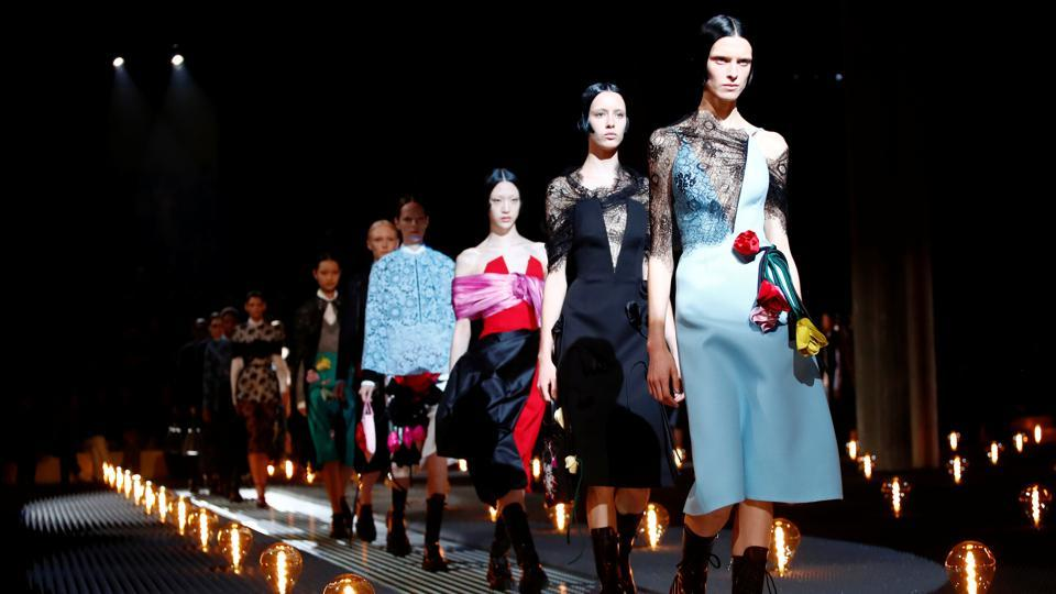 Models present creations by Prada during the Milan Fashion Week in Milan, Italy.