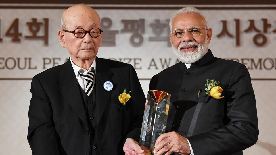 Prime Minister Narendra Modi receives the Seoul Peace Prize. In his speech, PM Modi touched upon cross-border terrorism and said that the time had come for all those who believe in humanity to join hands in the fight against terrorism. (ANI)