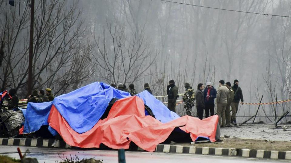 Lethpora: Security agencies inspect the site of suicide bomb attack at Lethpora area, in Pulwama district of south Kashmir, Friday, Feb. 15, 2019. At least 37 CRPF personnel were killed yesterday in one of the deadliest terror attacks in Jammu and Kashmir when a Jaish suicide bomber rammed a vehicle carrying over 100 kg of explosives into their bus in Pulwama district. (PTI Photo/S Irfan)(PTI2_15_2019_000037B)