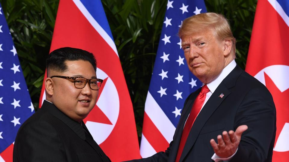 In this file photo taken on June 12, 2018 US President Donald Trump (R) gestures as he meets with North Korea's leader Kim Jong Un (L) at the start of their historic US-North Korea summit, at the Capella Hotel on Sentosa island in Singapore.