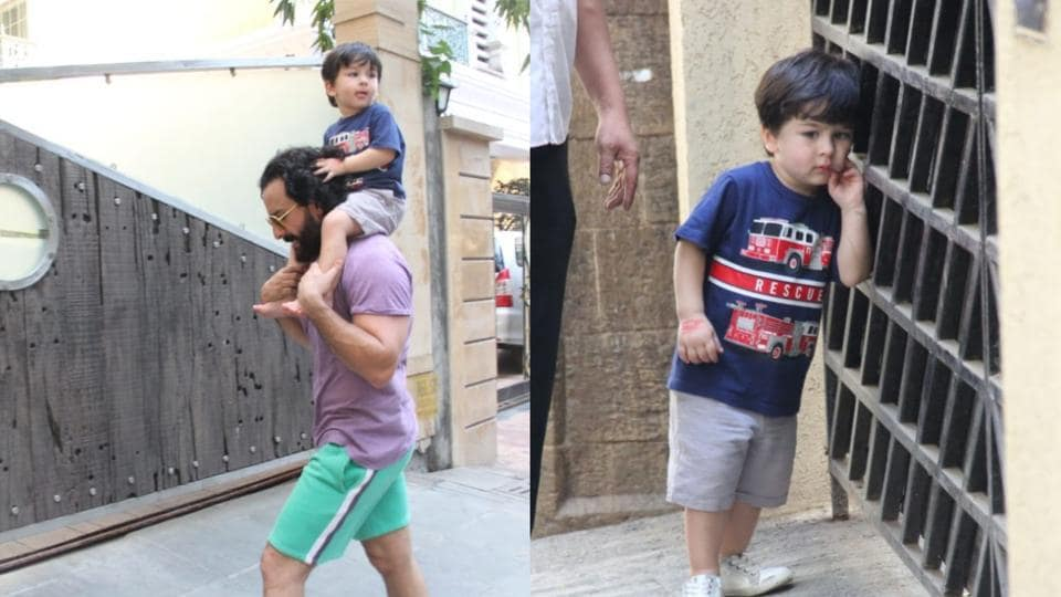 Saif Ali Khan spotted with son Taimur outside their residence.