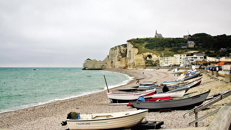 Planning a day trip? Visit Étretat's white cliffs and natural rock arches — the most popular sights in Upper Normandy, France