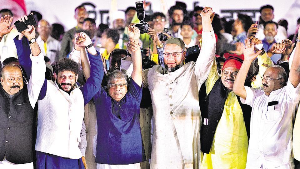Dalit leader Prakash Ambedkar with AIMIM chief Asaduddin Owaisi at the rally inShivajiPark on Saturday.