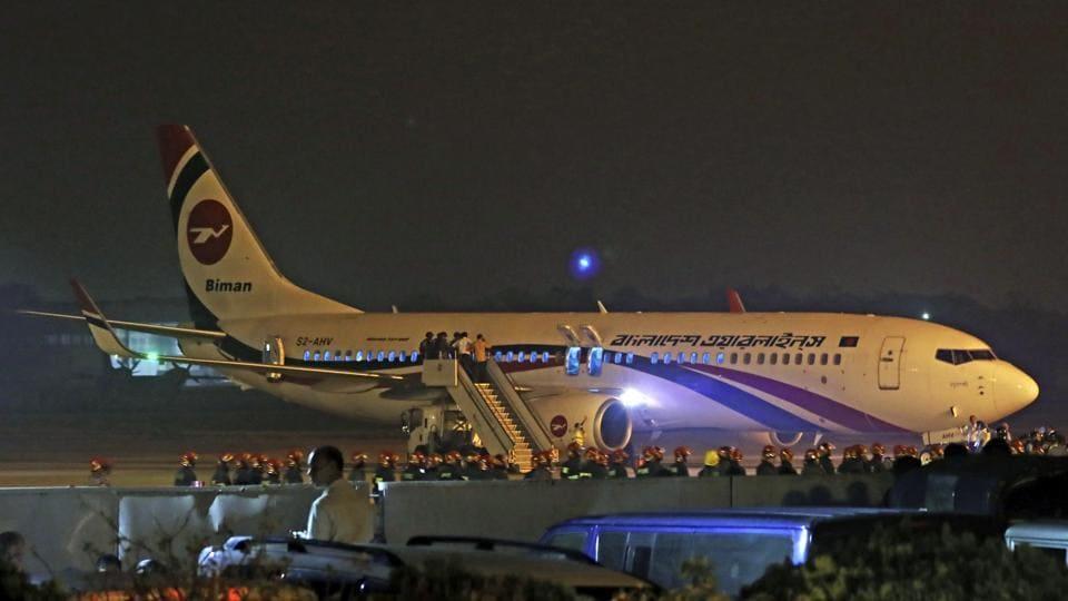 Bangladesh's state-run Biman Bangladesh Airlines flight is seen after it made an emergency landing at the airport in Chittagong, Bangladesh, Sunday.