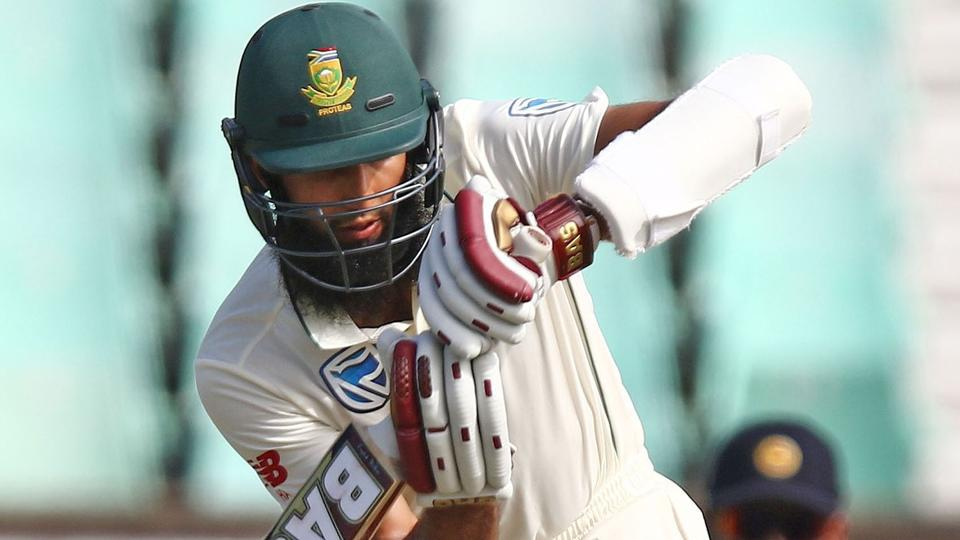 Hashim Amla hits the ball during the day 2 of the first test match between South Africa and Sri Lanka.