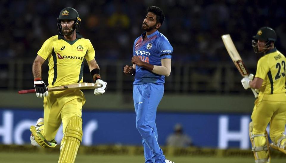 Australia's Glenn Maxwell and D'Arcy Short take a run against India during the first T20 international cricket match between India and Australia at the Dr YS Rajasekhara Reddy ACA–VDCA Cricket Stadium in Vizag