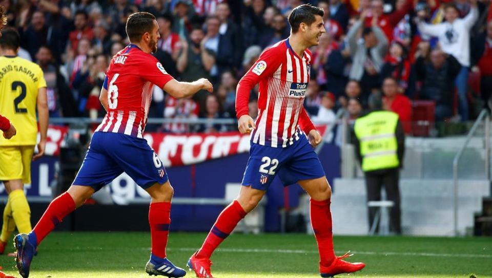 Atletico Madrid's Alvaro Morata celebrates scoring their first goal with Koke