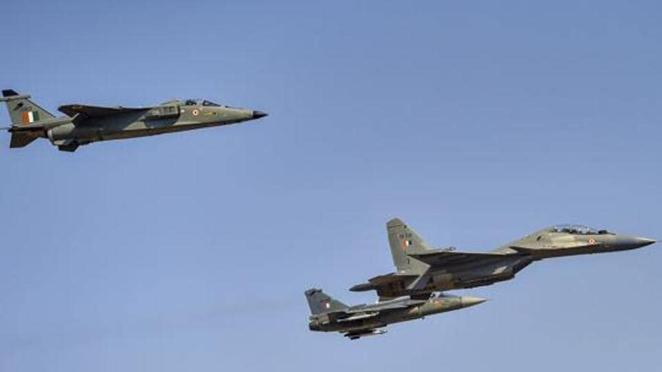 IAF's Sukhoi aircraft, a Jaguar and LCA Tejas fly in a 'missing man' formation to pay tribute to Wing Commander Sahil Gandhi who lost his life in a crash in Tuesday's rehearsals, during the inauguration of the 12th edition of AERO India 2019 air show at Yelahanka airbase in Bengaluru.