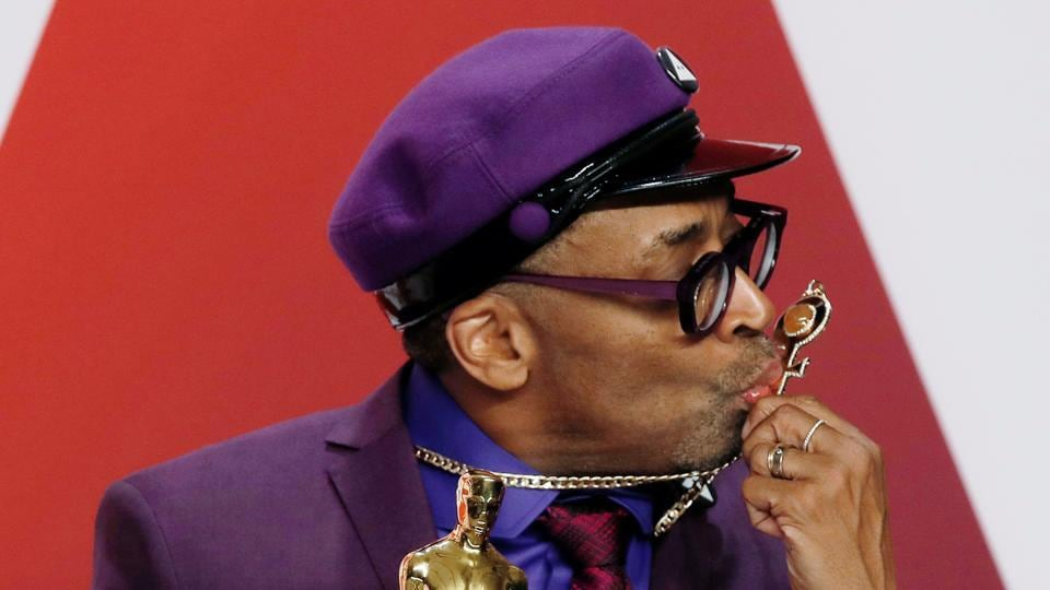 Oscars 2019: Spike Lee kisses his Prince necklace as he poses backstage with his Best Adapted Screenplay award for