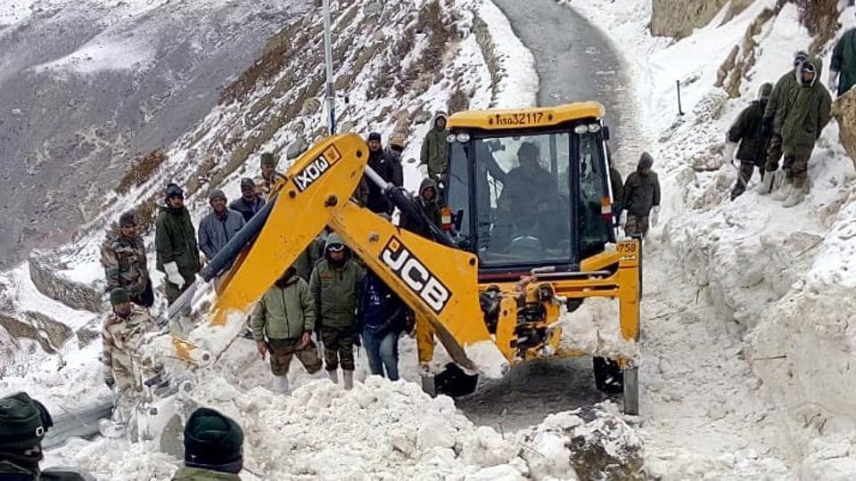 Army and ITBP personnel search for missing soldiers at avalanche site near Namgia in Himachal Pradesh on Monday.