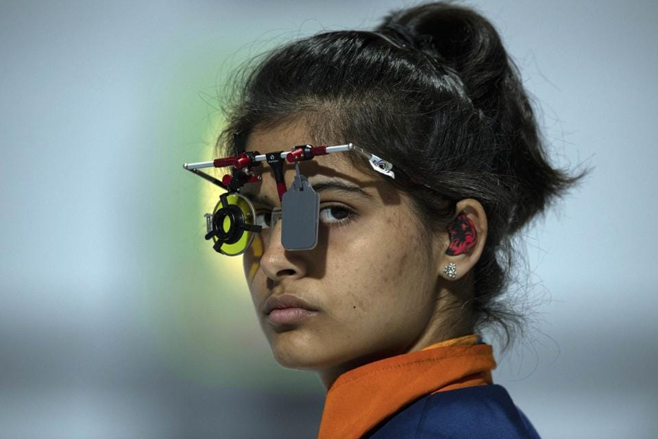In this photo provided by the OIS/IOC, Manu Bhaker of India competes in the shooting 10m air pistol mixed international team quarter-final , during the Youth Olympic Games in Buenos Aires, Argentina, Friday, Oct. 12, 2018