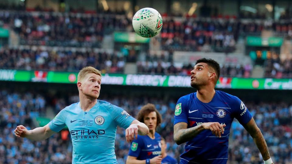 Kevin De Bruyne (left) vies for the ball with Chelsea's Emerson Palmieri  during their League Cup final clash on Sunday.