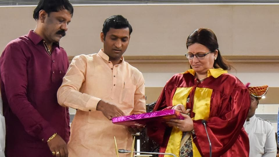 Yogesh Mulik, standing committee chairman, presents the PMC budget for 2019-2020 to mayor Mukta Tilak on Friday, February 22. (