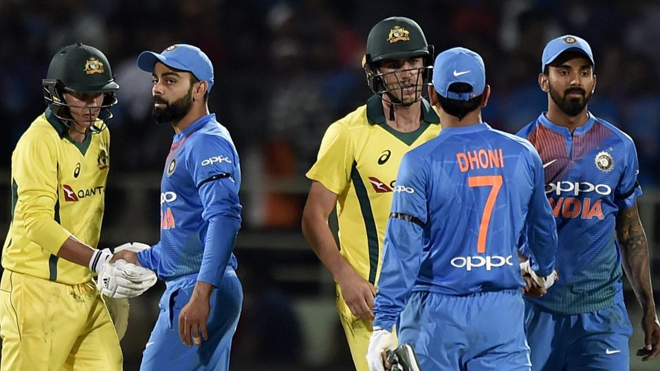 India's captain Virat Kohli and MS Dhoni greet Australia's Jhye Richardson and Pat Cummins after the first T20I in Vizag.