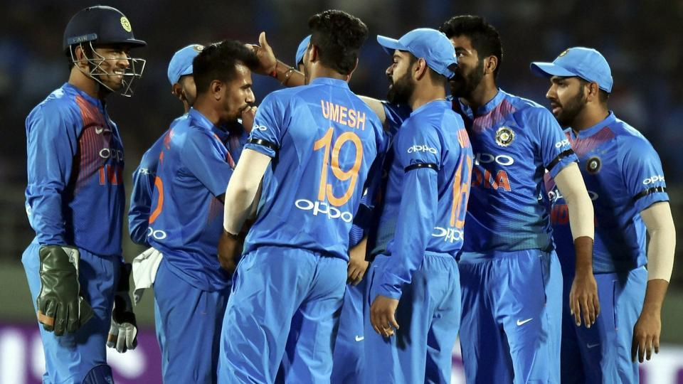 Yuzvendra Chahal with teammates celebrating after hits the stumps to run out Australia's Marcus Stoinis.