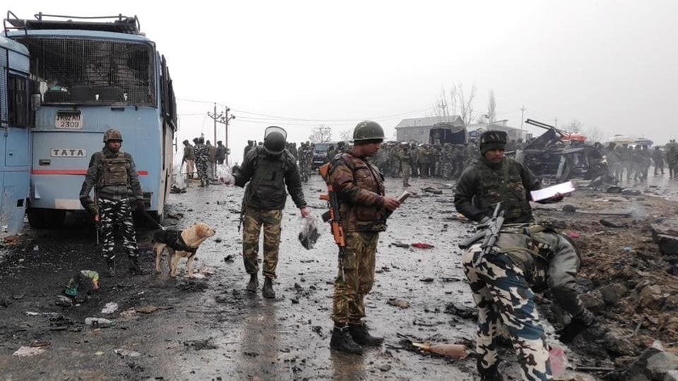 Soldiers examine the debris after an explosion in Lethpora in Kashmir's Pulwama district on February 14.
