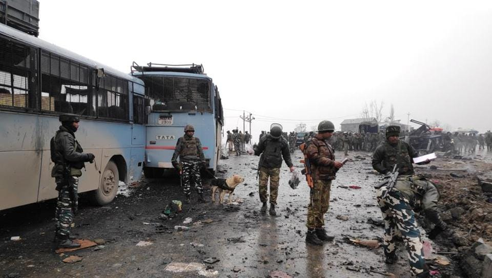 Soldiers at the explosion site in Lethpora in south Kashmir's Pulwama district.