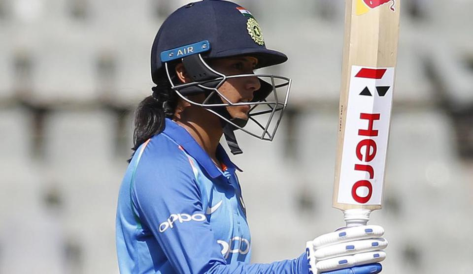 Smriti Mandhana raises her bat after scoring fifty during the second one-day international match.