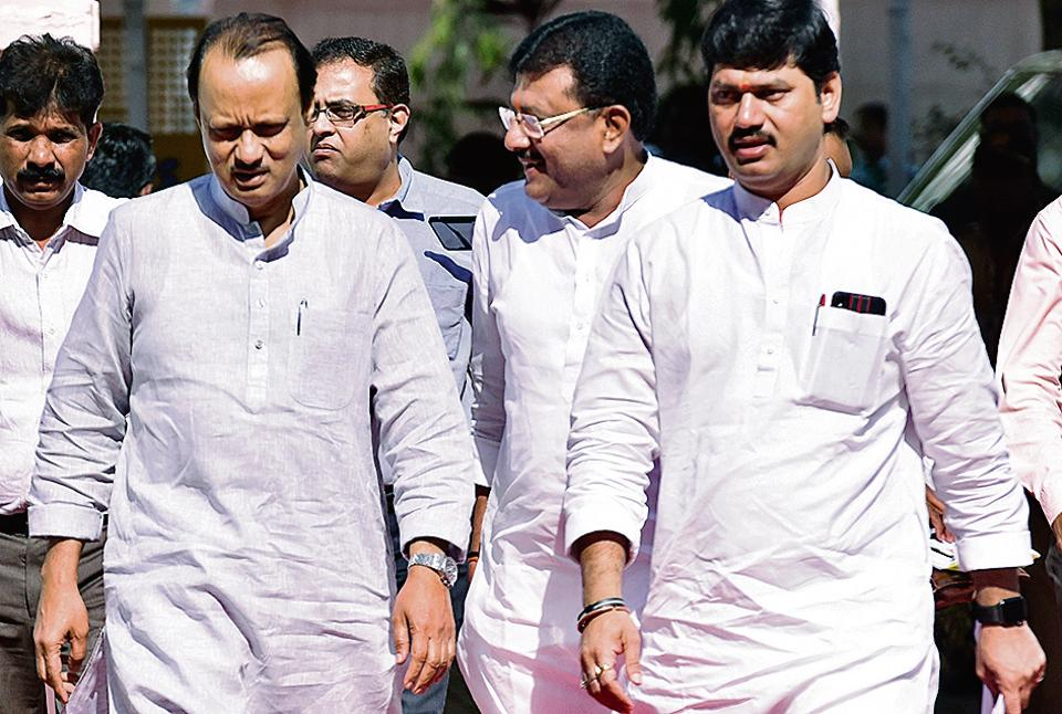 NCP leaders Ajit Pawar and Dhananjay Munde on the first day of the budget session at Vidhan Bhavan on Monday.