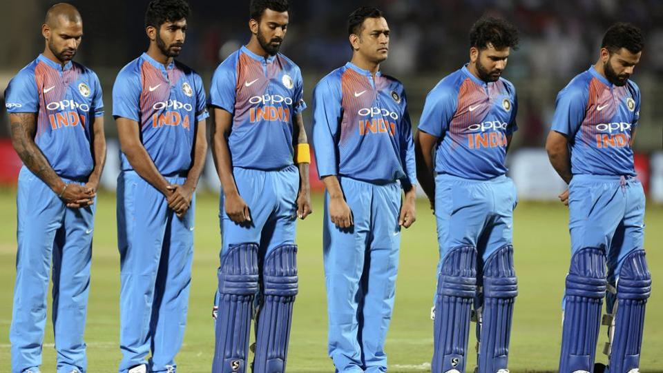 India's captain Virat Kohli, right and other players pay tributes to Indian soldiers killed in a suicide attack in Kashmir before the first Twenty20 international cricket match between India and Australia, at Visakhapatnam, India, Sunday, Feb. 24, 2019 (AP)