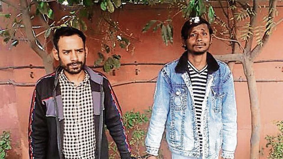 Arbaz Khan (left) and Noor Mohammad in police custody.