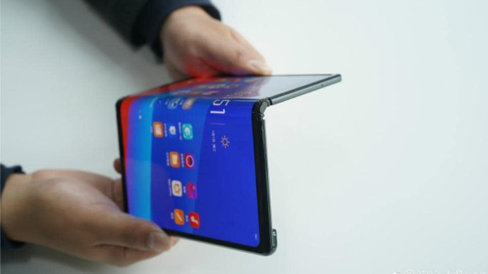 Oppo's VPBrian Shen shows off the company's foldable phone.