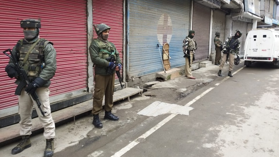 Policemen stand guard during  a search at the houses of separatist leaders in Srinagar on Tuesday.