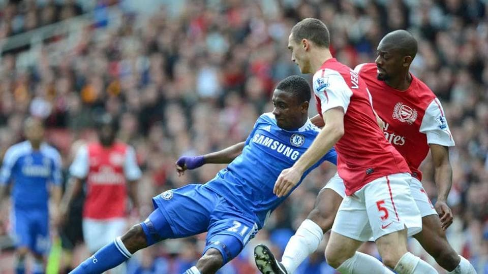 File image of Abou Diaby (R) and Thomas-Vermaelen (2nd R) vying for the ball with Chelsea's Salomon Kalou in April 2012.