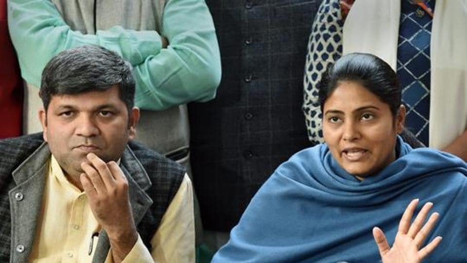 Apna Dal (S) leader Anupriya Patel with party President Ashish Patel addresses a press conference, in Lucknow