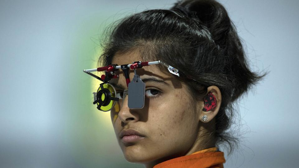 Manu Bhaker of India competes in the shooting 10m air pistol mixed international team.
