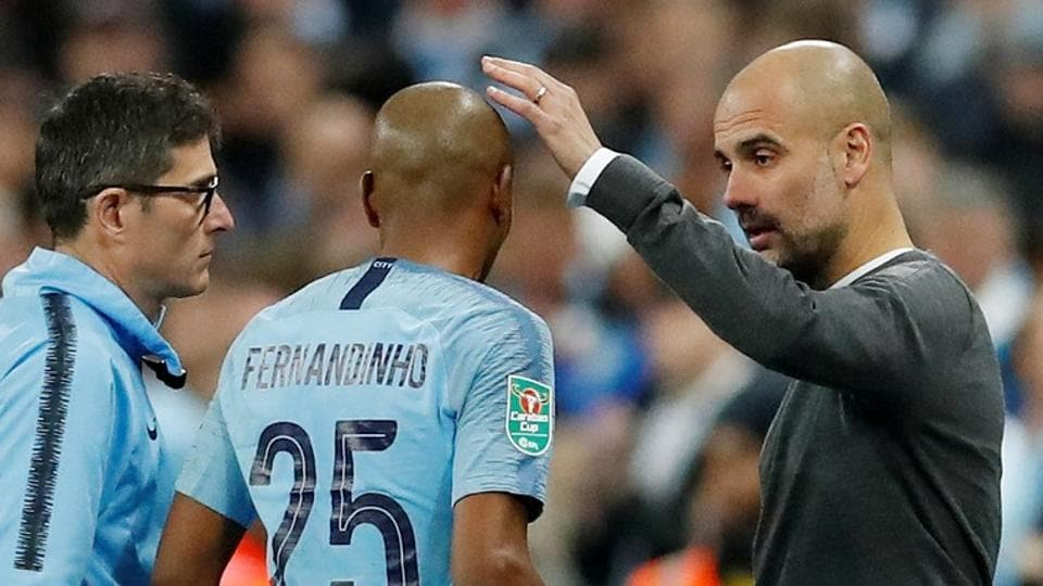 File image of Manchester City manager Pep Guardiola with Fernandinho.