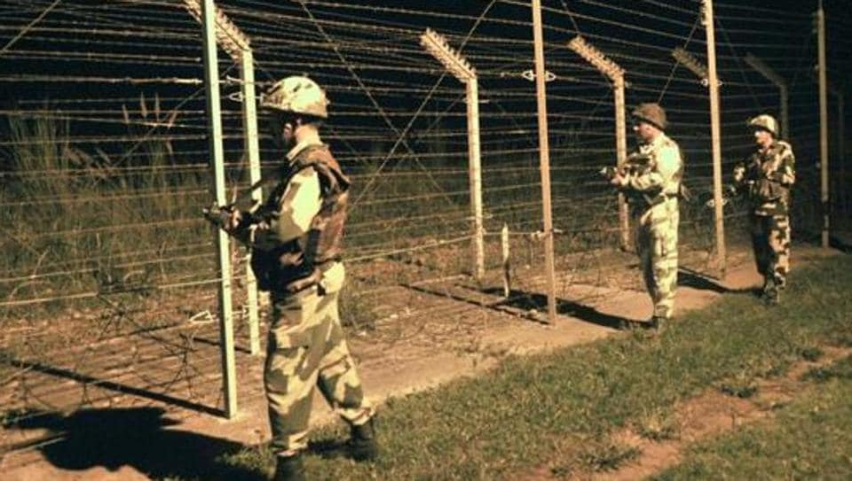 Border Security Force (BSF) soldiers standing guard during a night patrol near the fence at the India-Pakistan International Border at the outpost of Akhnoor sector, about 40 km from Jammu. Image for representation.