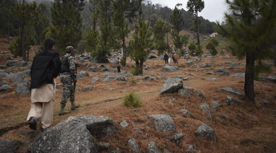 Pakistani reporters and troops visit the site of an Indian airstrike in Jaba, near Balakot, Pakistan, Tuesday, Feb. 26, 2019.