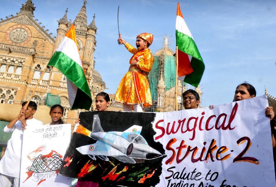 People celebrate the air strike carried out by the Indian Air Force on terrorist camps in Pakistan on Tuesday.