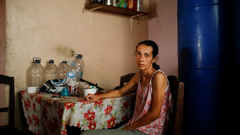 Yaneidi Guzman poses for a picture at her home in Caracas, Venezuela. Guzman has lost a third of her weight over the past three years as Venezuela's economic collapse made food unaffordable and she now hopes the opposition will succeed in bringing urgently needed foreign aid to the South American country. (Carlos Garcia Rawlins / REUTERS)