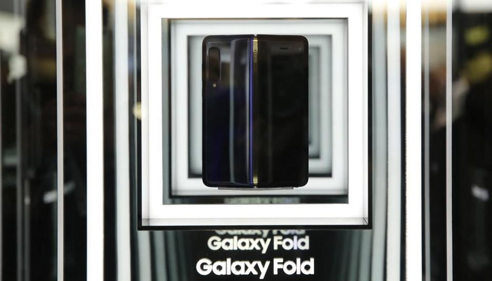 A Galaxy Fold smartphone stands on display at the Samsung Electronics Co. pavilion on the opening day of the MWC Barcelona in Barcelona.