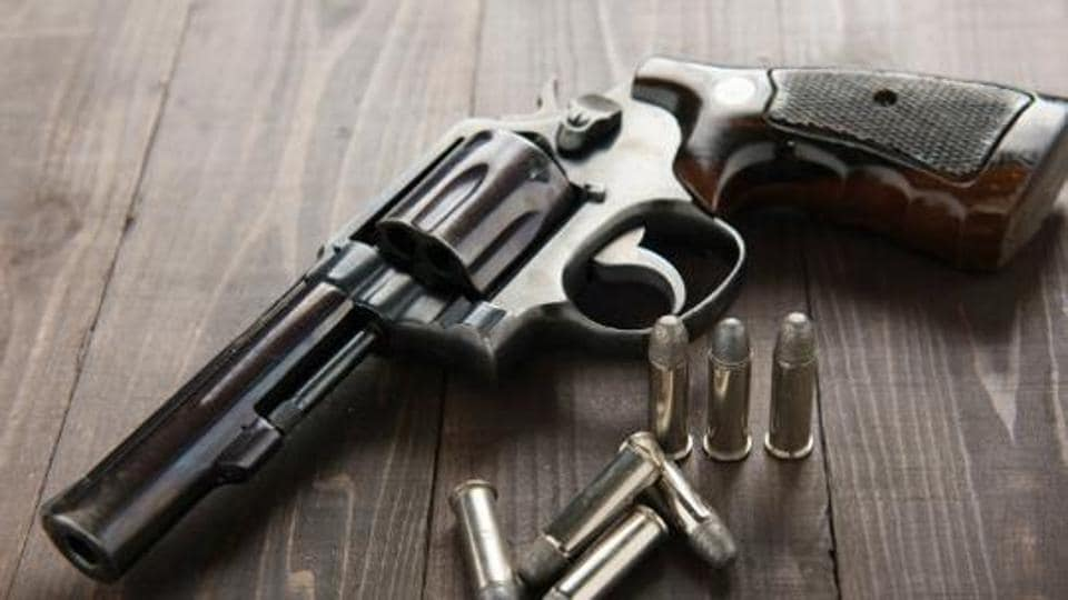 Three countrymade revolvers and 10 live bullets were seized from the accused.