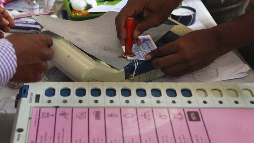 Election Commission staff sealing the Electronic Voting Machines (EVMs). (Photo by Kalpak Pathak / Hindustan Times)