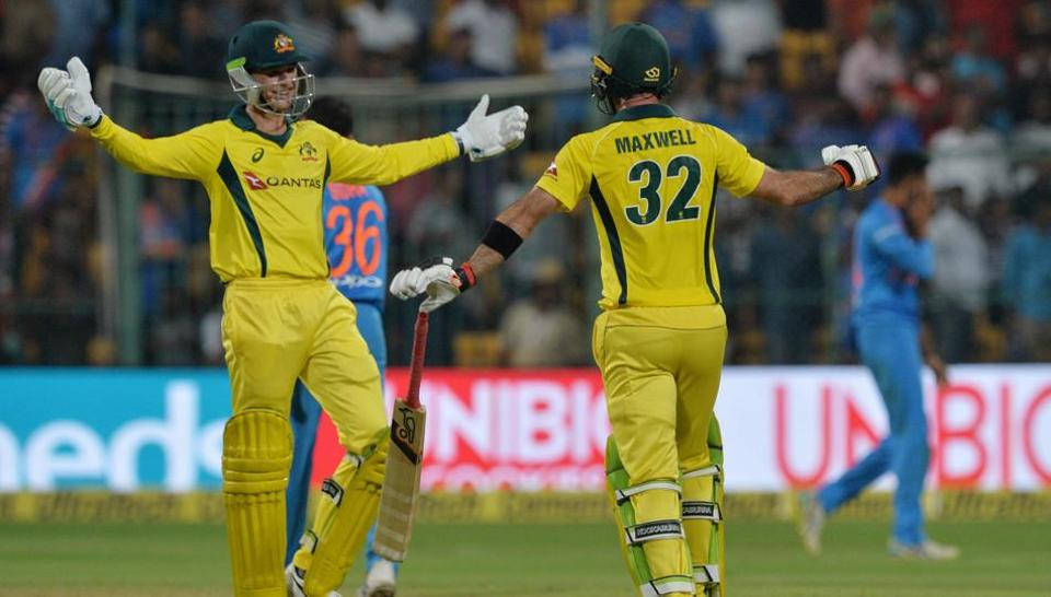 Australian batsmen Glenn Maxwell (R) and Peter Handscomb embrace after victory in the second Twenty20 international cricket match between India and Australia at The M. Chinnaswamy Stadium in Bangalore on February 27, 2019 (AFP)