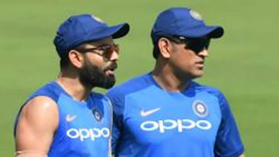 Indian cricket team's captain Virat Kohli (L) with Mahendra Singh Dhoni attend a training session.
