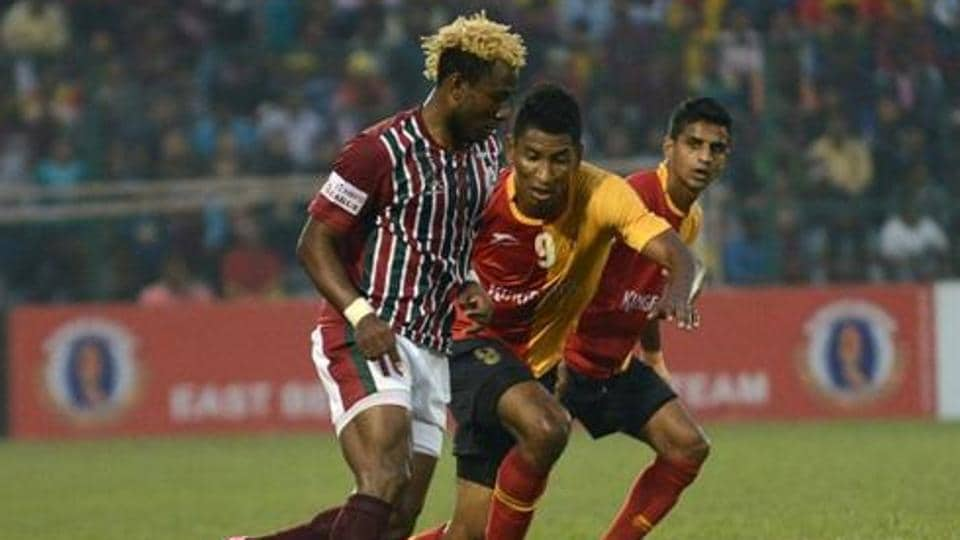 File image of Mohun Bagan's Sony Norde (L) being tackled by East Bengal's Willis Deon Plaza (C) as Mehtab Hossain looks on.