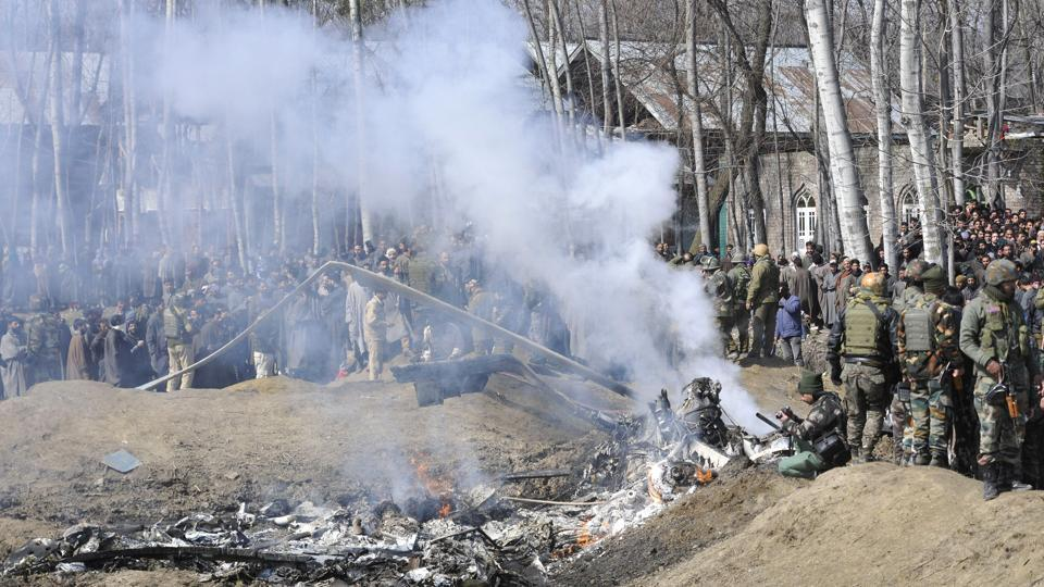 Two pilots were killed today after an Indian Air Force M-17 chopper crashed in Jammu and Kashmir's Budgam district. The chopper crashed due to technical reasons, officials said, close to the Srinagar airport in an open field near Garend Kalaan village in Budgam around 10 am. The aircraft broke into two and caught fire immediately. (Waseem Andrabi / HT Photo)