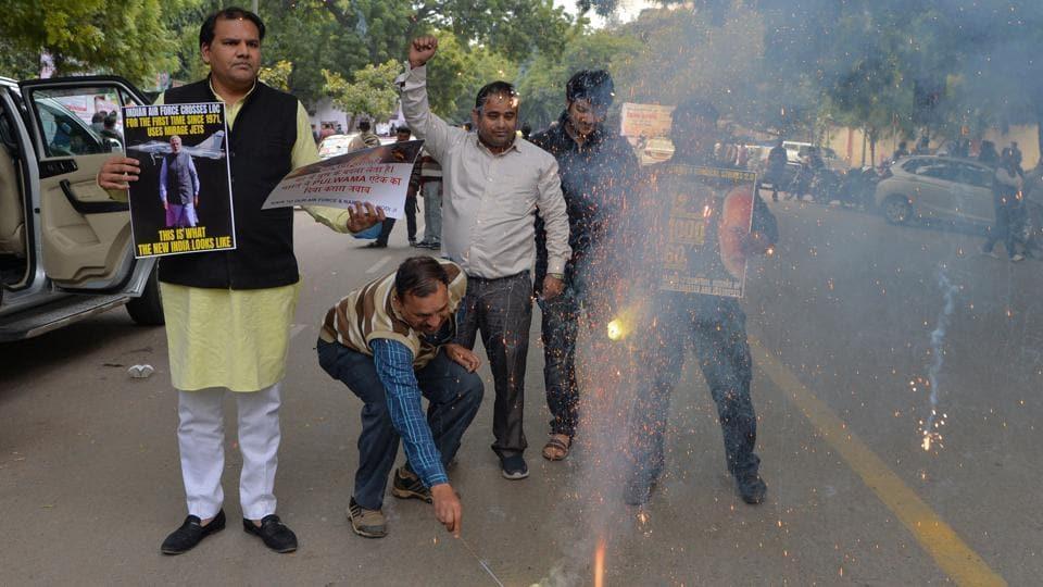 People burst crackers in New Delhi after IAF's strike on Jaish terror camps across LoC.