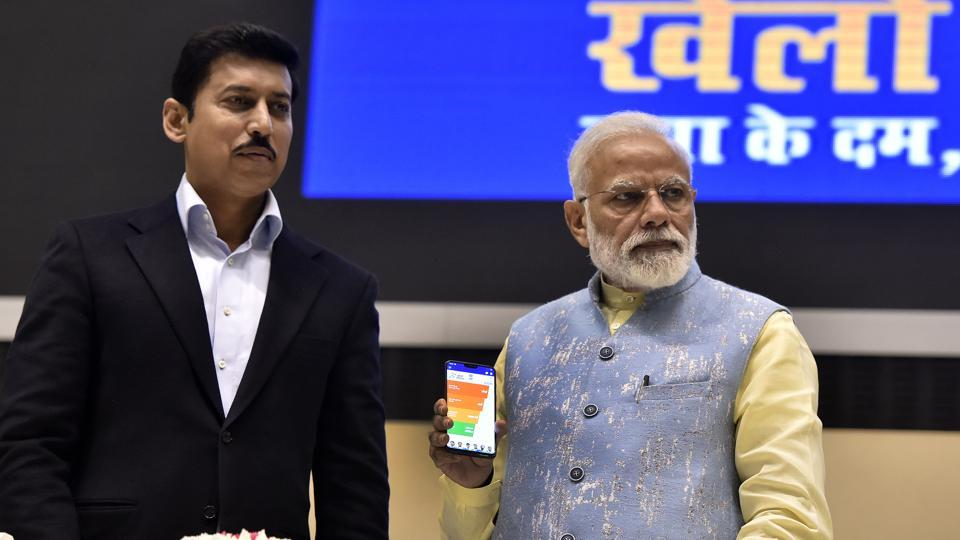 New Delhi, India - Feb. 27, 2019: Prime Minister Narendra Modi with Youth and Sports Minister Rajyavardhan Rathore launches the 'Khelo India' mobile application