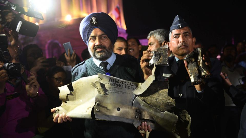 IAF officers show sections of an exploded AMRAAM missile, said to be fired by Pakistan Air Force (PAF) F-16s which were found in Rajouri district.