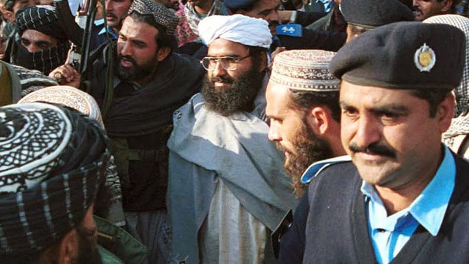 A file photo of Masood Azhar, center, (wearing glasses and white turban), leader of Jaish-e-Mohammad, in Islamabad, Pakistan.