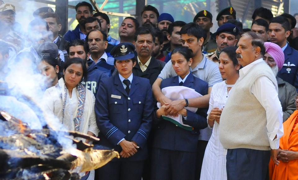 The last rites of Squadron Leader Siddharth Vashisht, who died in a helicopter crash in Jammu and Kashmir's Budgam district, were performed in Chandigarh with full military honours. In uniform, the deceased officer's wife, Aarti, who is also a squadron leader was seen holding the tricolour. Vashisht (31) was a fourth-generation member from his family in the armed forces. (Anil Dayal / HT Photo)