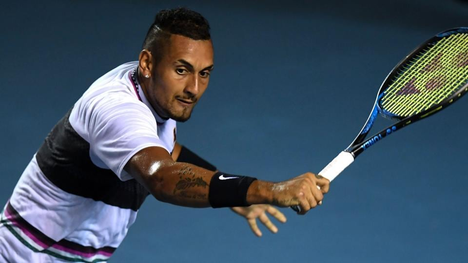 Australian tennis player Nick Kyrgios returns the ball to Spanish tennis player Rafael Nadal (out of frame) during their Mexico ATP 500 Open men's single tennis match in Acapulco.