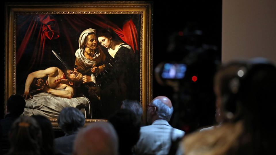"A painting, believed to be the second version of ""Judith Beheading Holofernes"" by Italian artist Michelangelo Merisi da Caravaggio, is pictured during a photocall in London following its restoration. It is a burst of violence painted in haunting tones by a Renaissance master worth at least $100 million -- or yet another fake distressing the art world. (Daniel Leal-Olivas / AFP)"